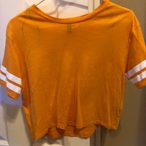 yellow t-shirt with white stripes on the sleeves